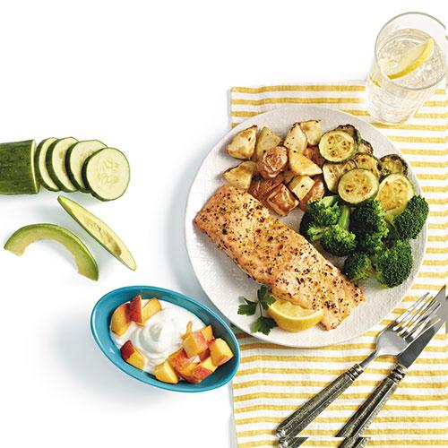 overhead shot of salmon zucchini broccoli on plate