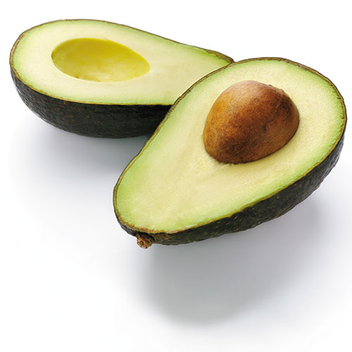 split avocado showing pit