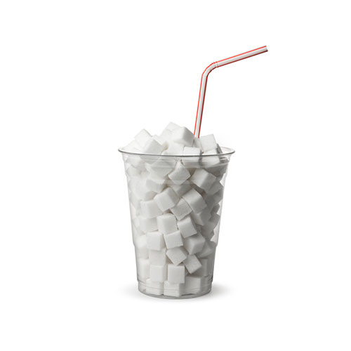 clear plastic cup and straw filled with sugar cubes