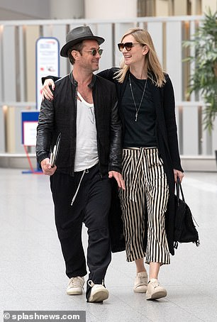 Jude Law, 46, with new wife Phillipa Coan, 32, en route to France