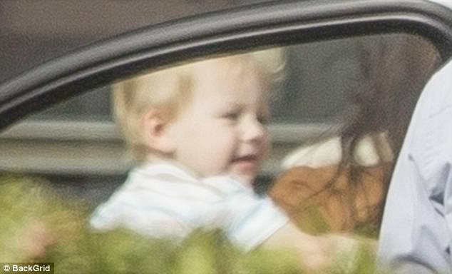 Cherubic child:Meanwhile, the former couple's 23-month-old baby boy appeared to be in good spirits in his cute striped polo shirt, grey jeans, and Converse high-tops