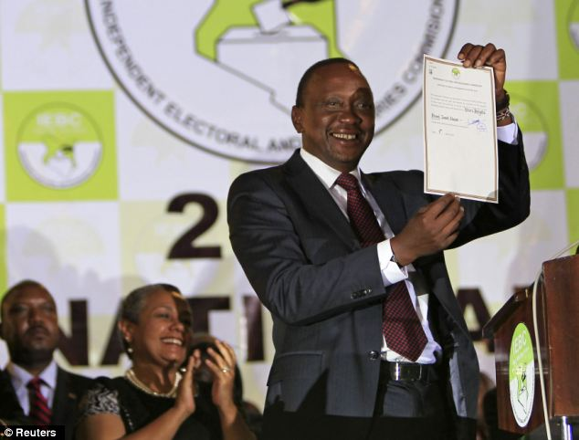 President-elect Uhuru Kenyatta displays the certificate from Independent Electoral and Boundaries Commission declaring him the winner