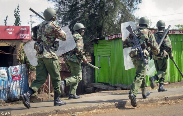 Police with the General Service Unit engage in running battles with supporters of Kenyan presidential candidate Raila Odinga, shortly after the announcement