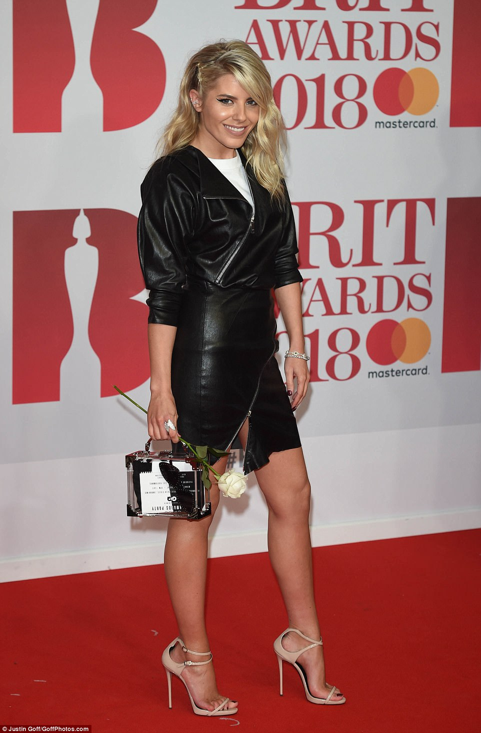 What day of the week is it? The Saturdays star Mollie King opted for an edgy biker ensemble which flashed her lean legs as she arrived on the red carpet with her white rose