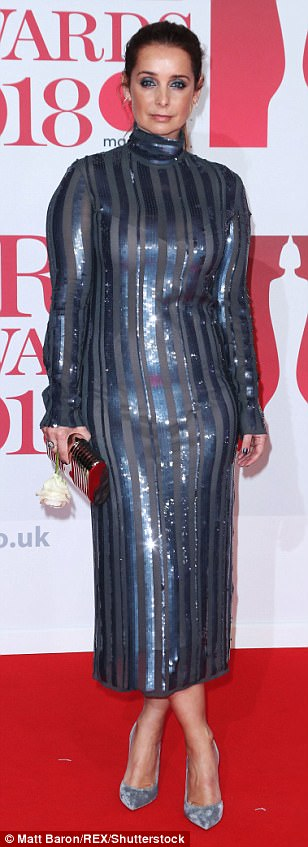 Glittering: Newly single Louise Redknapp made a showstopping appearance on the red carpet as she showed off her figure in a striped blue dress which proved to be slightly semi-sheer
