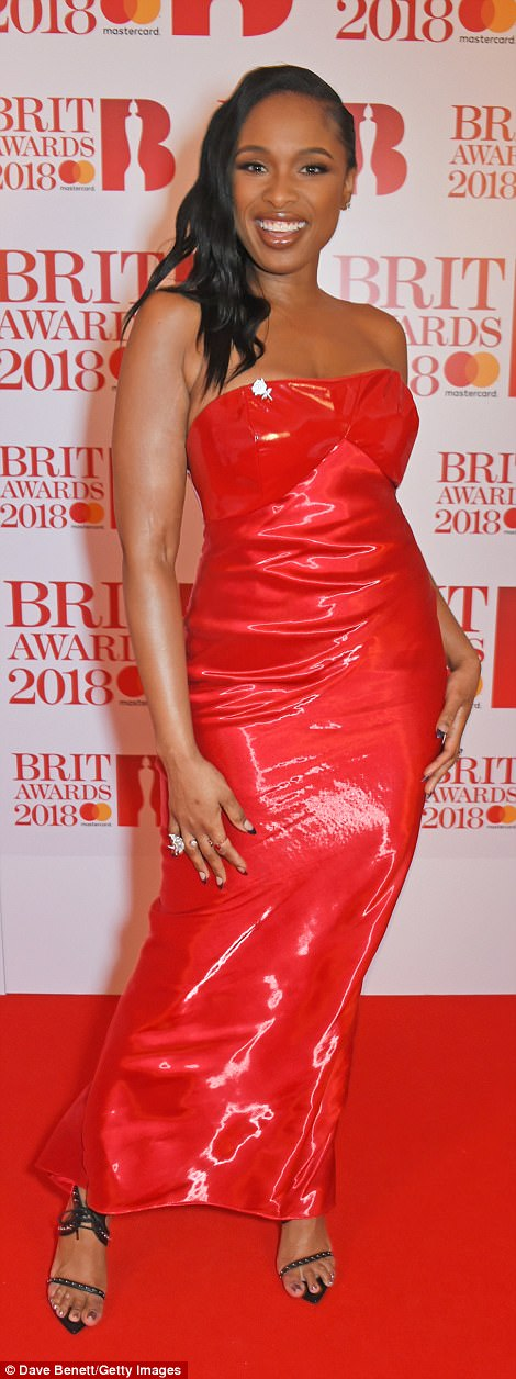 Wow: Jennifer Hudson looked absolutely smoking hot in a strapless red PVC number which drew focus to her curvaceous form