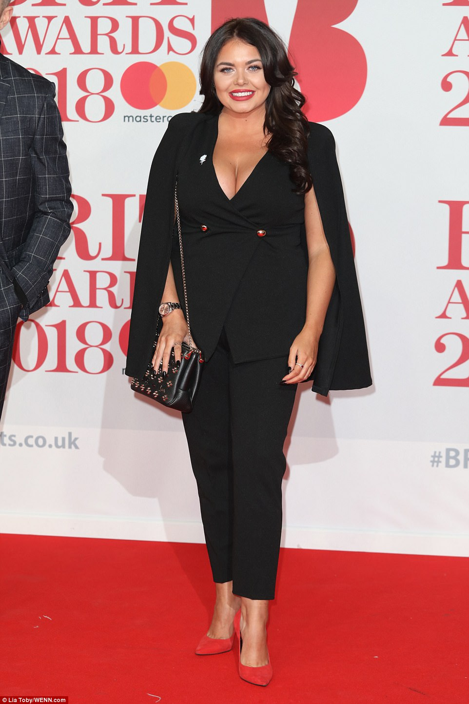Scarlett Moffatt slipped her killer curves into a plunging black cape-style blazer for the star-studded bash