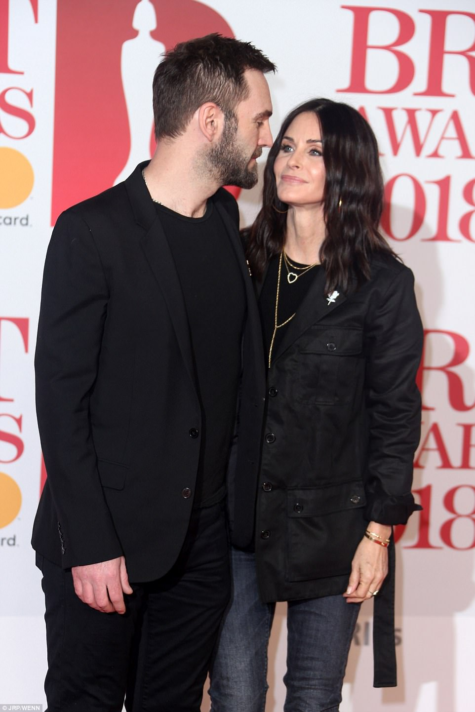 Eyes for each other: Despite the breakdown of her pal Jennifer Aniston's marriage to Justin Theroux, the pair proved they were very much in love as they couldn't keep their eyes off other