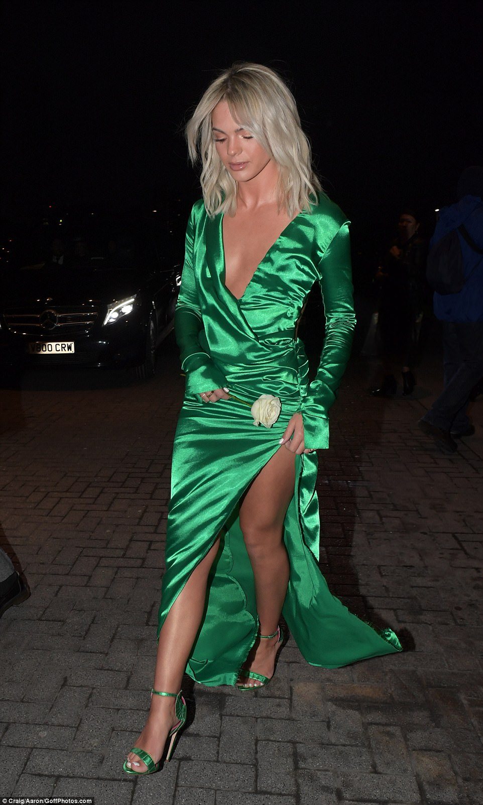 Bright: The plunging neckline offered a daring edge to the look and she added a matching pair of strappy heels to the emerald ensemble