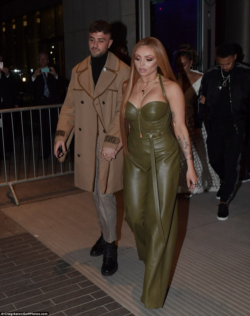 Hand-in-hand: The couple made their red carpet debut one whole year after Jesy was spotted kissing Chris Clark at the event