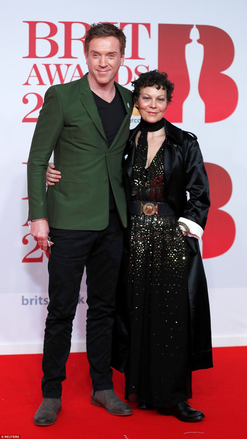 Smitten pair: Damian Lewis and Helen McCrory looked very much in love as they arrived on the red carpet