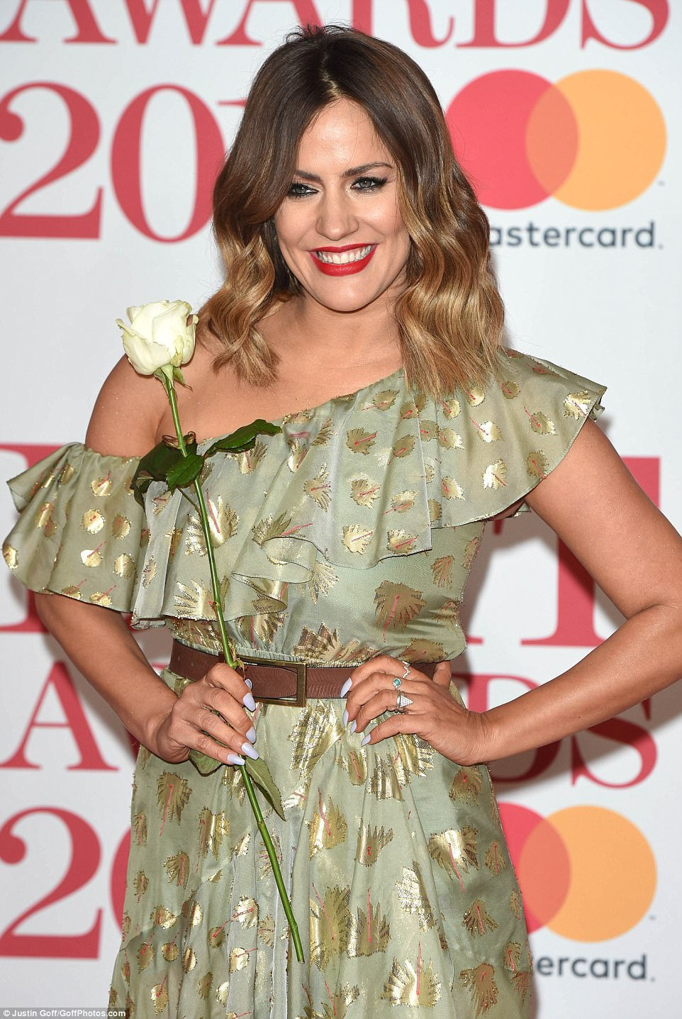 Striking: The Love Island presenter, 38, accentuated her pretty features with a bold red lip while her dip-dyed locks fell in loose waves upon her shoulders
