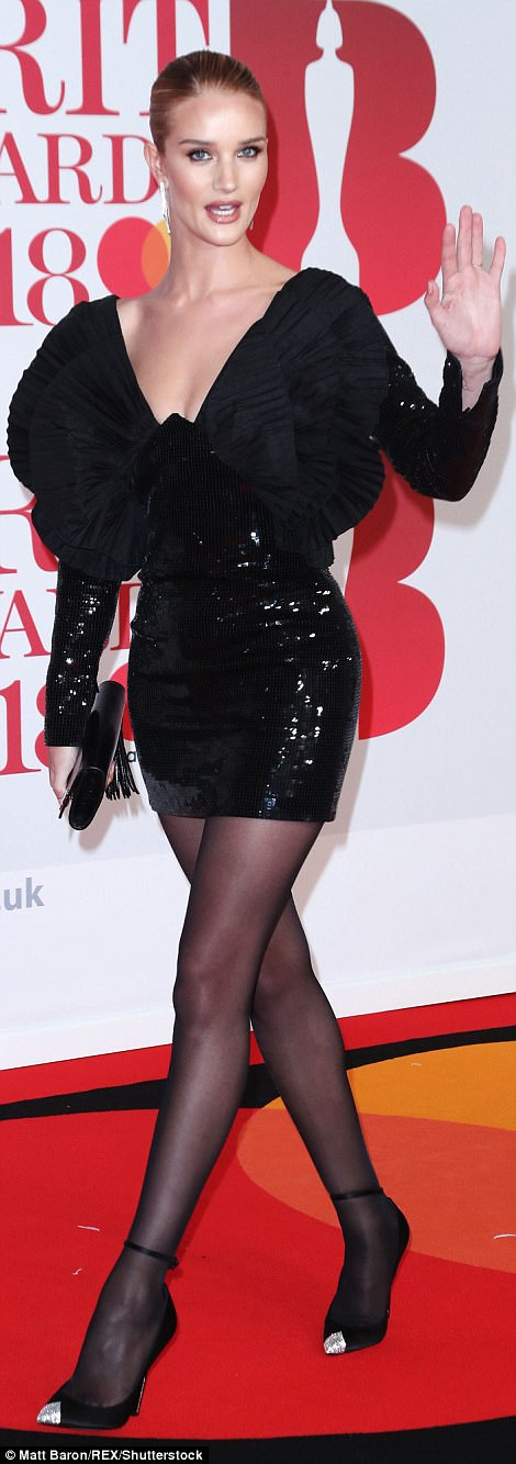 Glittering beneath the red carpet lights, the thigh-skimming Saint Lauren outfit ensured Rosie, 30, stood out as she mingled with guests ahead of the annual ceremony
