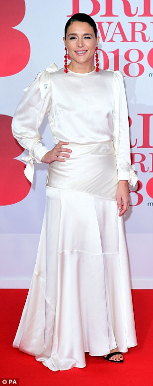 Chic: Jessie Ware proved to be effortlessly demure in a lively in a figure-hugging white gown which she teamed with black open-toe heels