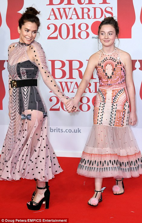 Girls' night out! Gracie and Anna, 41, turned up in matching dresses - albeit Anna's was far more risqué - that looked to be vintage-inspired