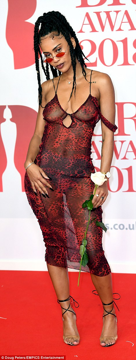 Raunchy: Making for one of the boldest looks of the night, IAMDDB went braless under a semi-sheer animal print number
