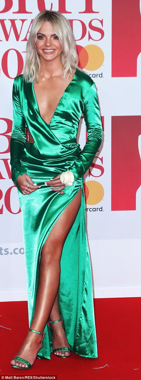 Green with envy: The 20-year-old Best Behaviour singer showcased her lithe physique in the floor-length gown which perfectly flashed hints of her torso and her deeply tanned limbs