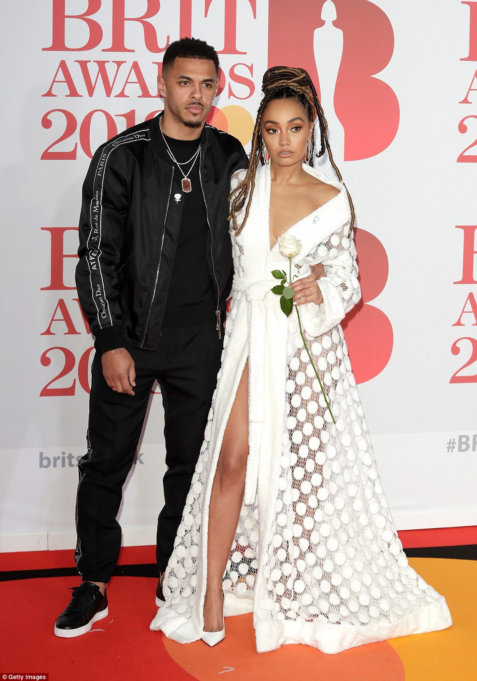 With her man: Leigh-Anne was joined by boyfriend Andre Gray at the event as she turned heads in her eye-catching white gown, matching stilettos and diamond jewellery by Beards