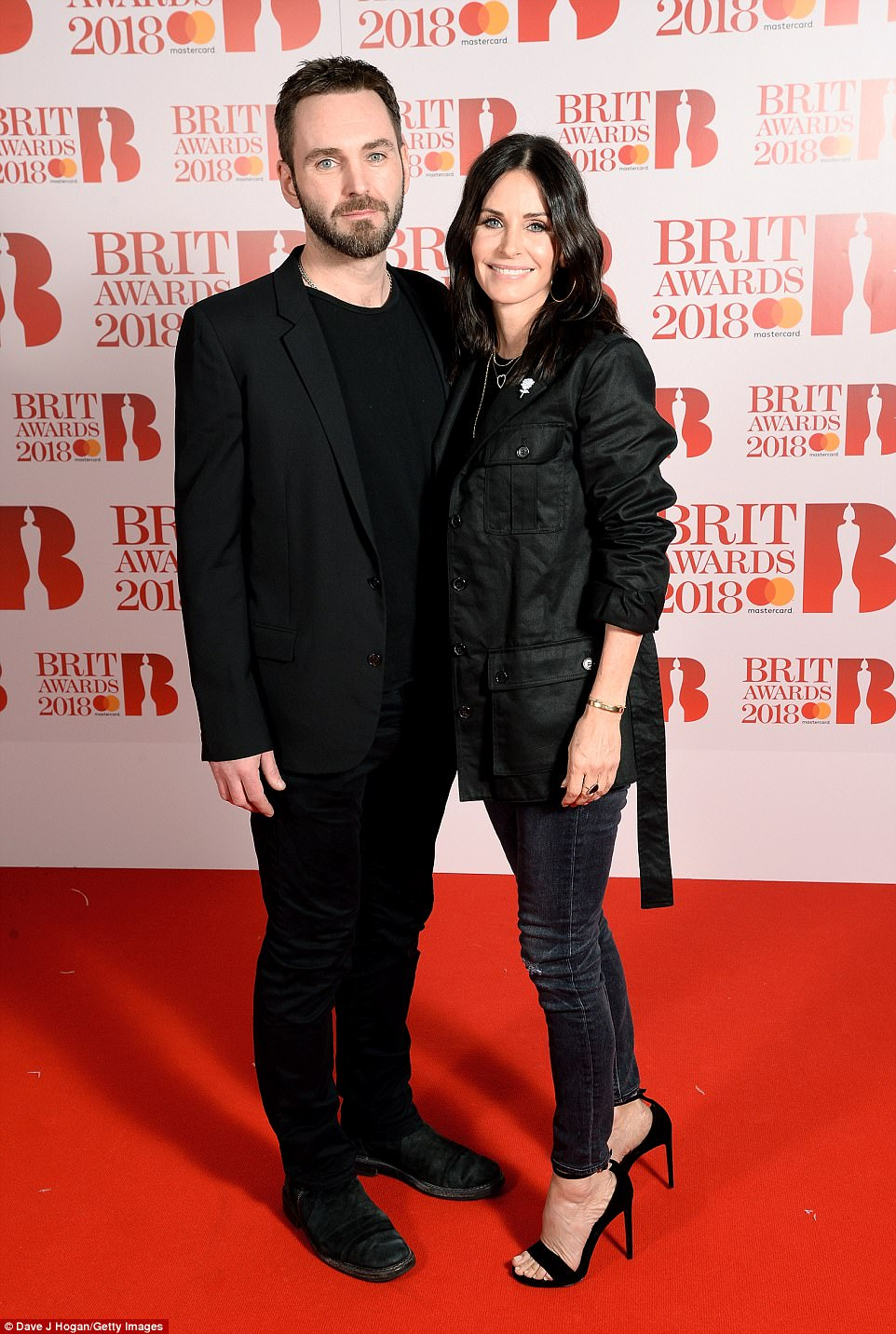 Besotted: Former Friends star Courteney Cox couldn't have looked more happier as she arrived on the arms of her other half Johnny McDaid