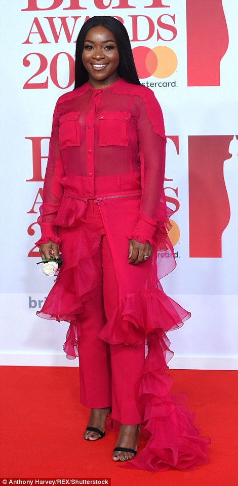 Dripping in diamonds: Ray BLK a wore Tiffany & Co ring and bracelet that complemented her hot pink co-ord complete with a train