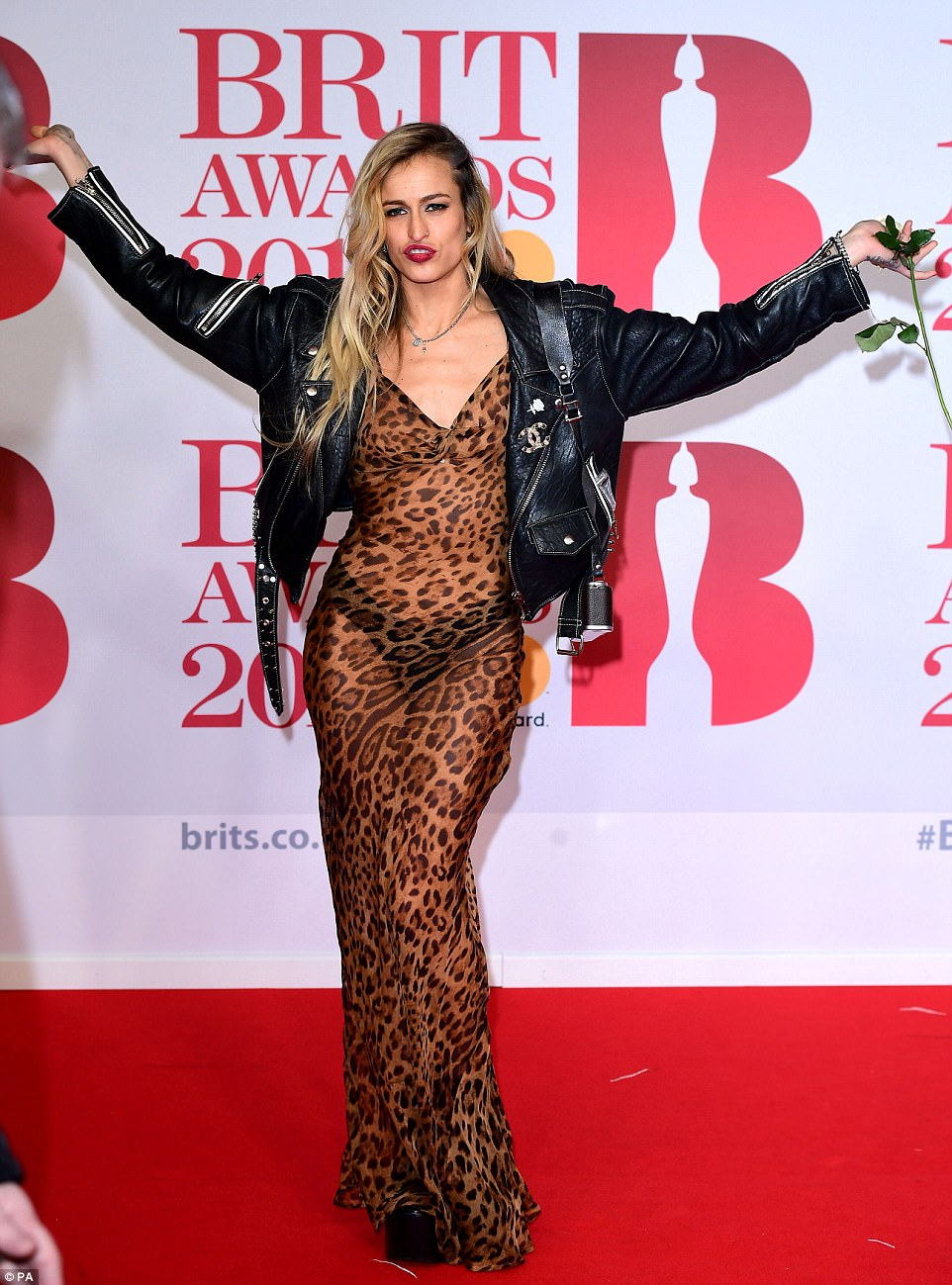 Statement: Supermodel Alice Dellal looked every inch the grunge icon in a leopard print dress and biker jacket