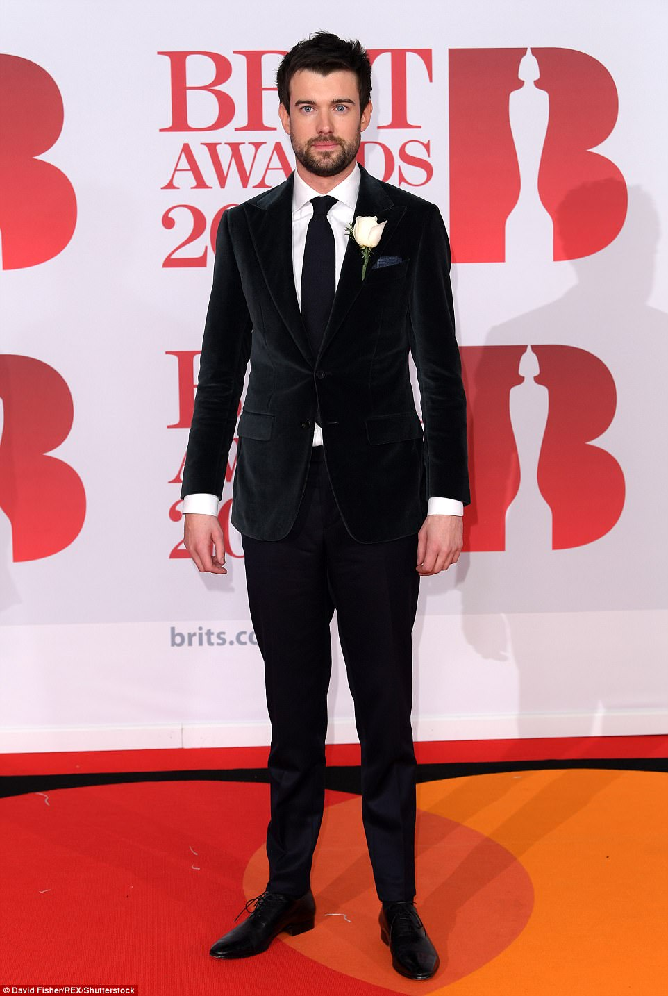 Host for the night Jack Whitehall looked handsome in a deep green velvet suit, crisp white shirt and navy tie