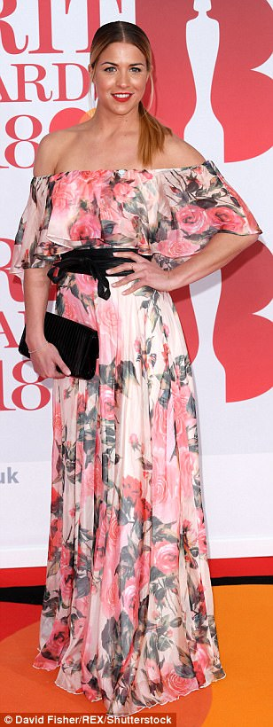 Flower power: Gemma Atkinson, 33, dazzled in a stunning pink and white floral bardot gown as she made an impact on the star-studded red carpet