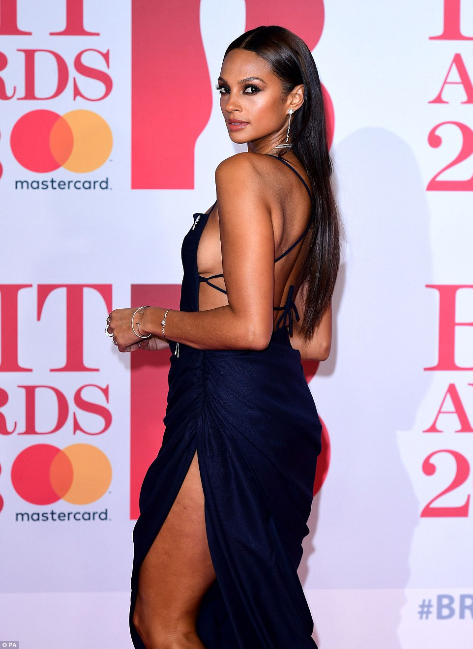 Flawless: The singer, 39, flashed some serious sideboob in a navy ruched dress with a thigh high split, as she arrived for the ceremony with her dapper other half