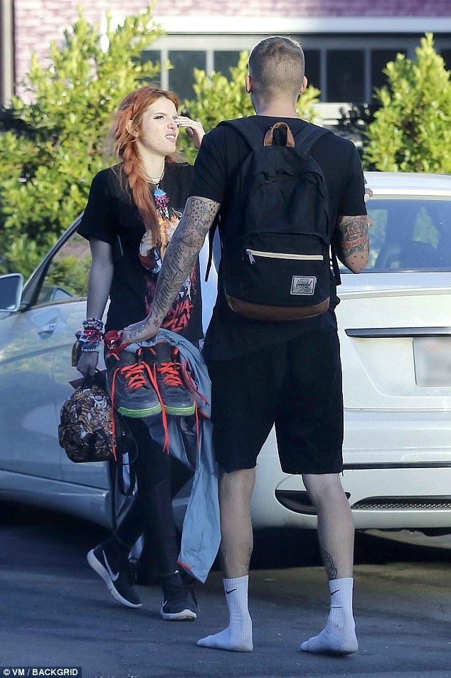 The wee morning: Bella was seen with a mystery man...who was not wearing his shoes