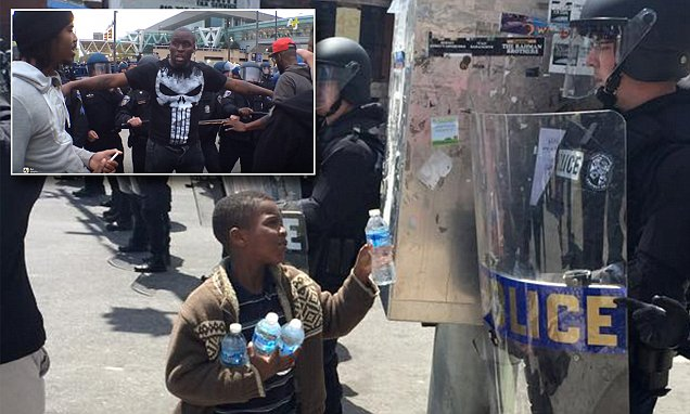 Incredible photos of kindness during Baltimore riots