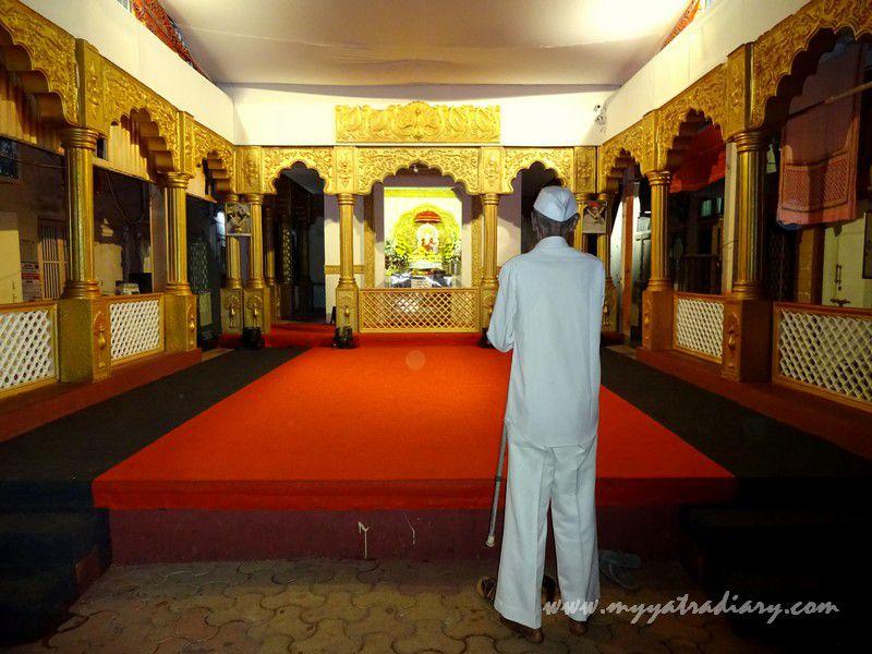 A man prays at Mumbai's first Sarvajanik Ganeshotsav Mandal -  Keshavji Naik Chawl Ganpati in Girgaon, Mumbai.