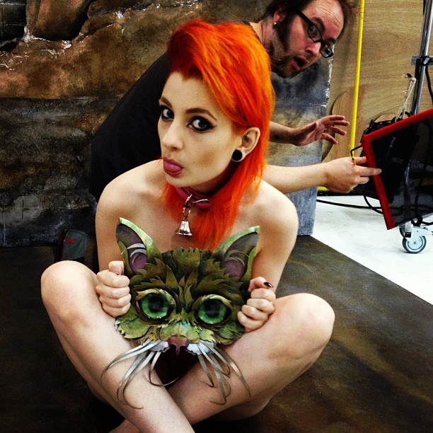 if you're gonna photo bomb, shouldn't be behind a neked model wearing a cat mask?