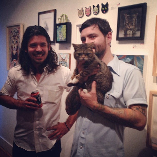 Spoke art gallery owner Ken Harman, Lil Bub and her owner Mike Bridavsky charming the crowd during the Lil Bub Art Show opening.