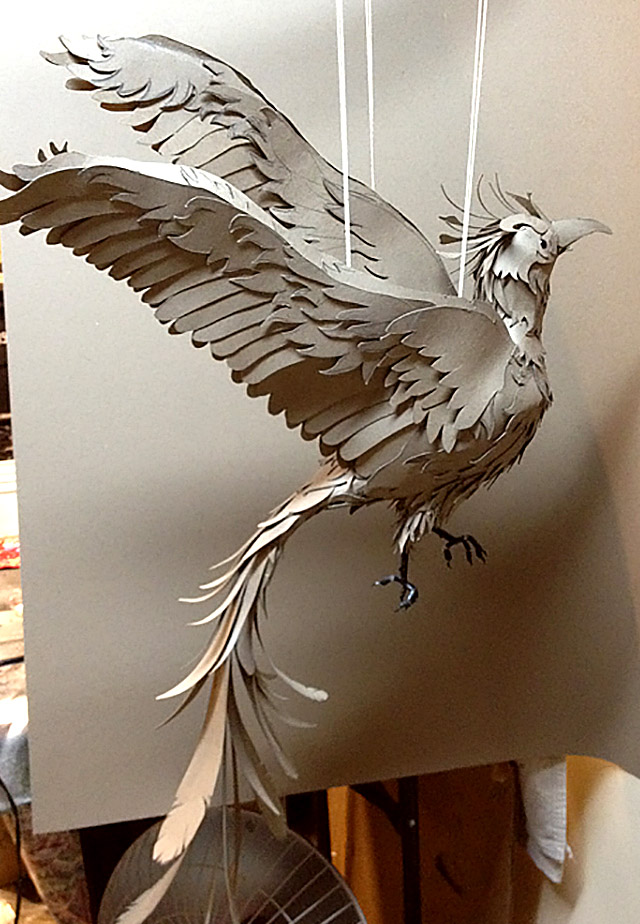 Unpainted 'released' bird with all it's feathers in place - view 1