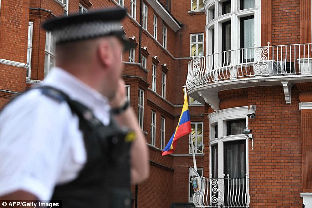 A police officer walks past the Ecuadorian embassy in London this morning as it emerged that Sweden had dropped its investigation into Julian Assange