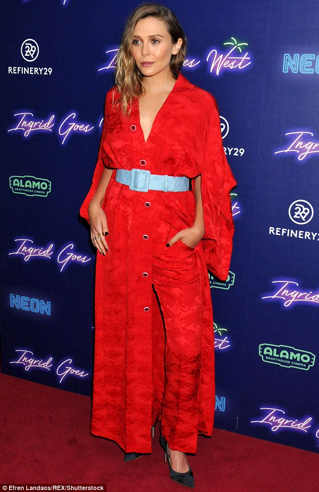 She sizzles! The younger sister of Mary Kate and Ashley radiated vintage vibes in a red Rosie Assoulin jumpsuit which plunged to reveal her smooth chest
