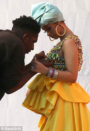Salsa queen: The hitmaker is paying homage to Latina singer Celia Cruz, choosing her bright yellow skirt and beaded top to channel the Cuban icon