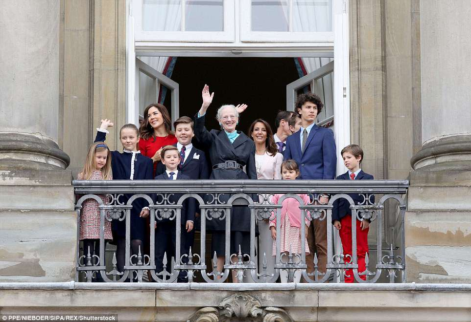 Royal support: Queen Margrethe, who turned 78 on Monday, seen centre, was joined on the balcony by (from left) Princess Josephine, Princess Isabella, Crown Princess Mary, Prince Vincent, Prince Christian, Princess Marie, Prince Joachim (just seen), Princess Athena, Prince Felix, Prince Nikolai, and Prince Henrik