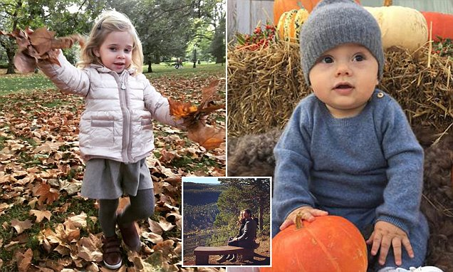 Prince Oscar of Sweden is pictured sitting up for the first time on a visits to a pumpkin