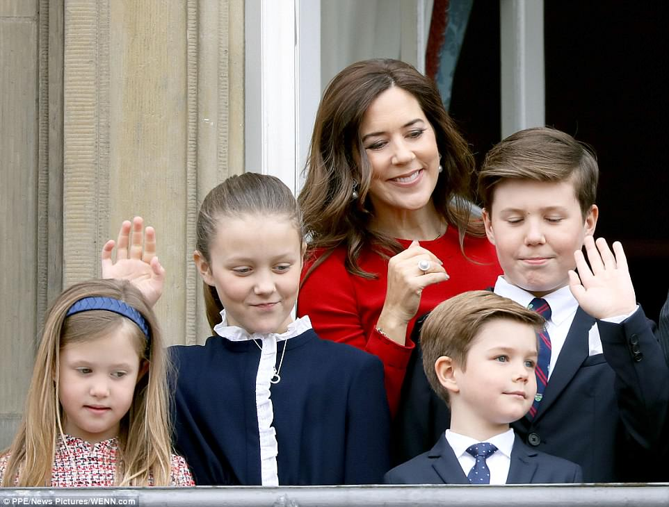 The Crown Princess' four children with the Queen's heir, Prince Frederik all share the same fair skin and light brown hair