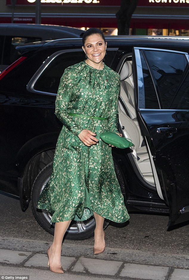 Scandi style: Victoria donned a vibrant patterned frock as she stepped out in Stockholm to attend a seminar on the importance of clean water at the Teater Pero in the city centre