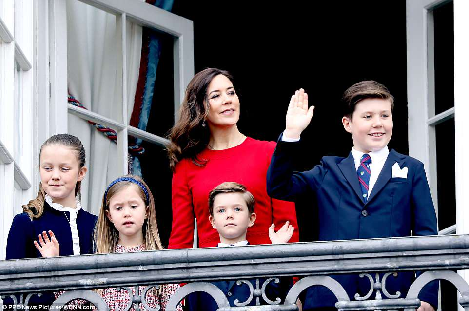 Crown Princess Mary, surrounded by her children Princess Isabella, 10, seven-year-old twins Josephine and Vincent, and 12-year-old Prince Christian, looked glamorous in a red dress