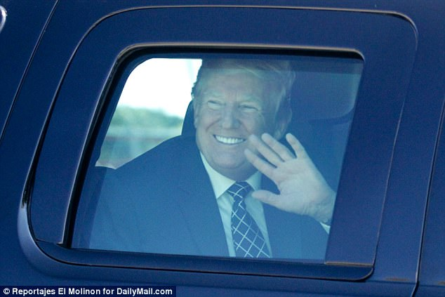 He is seen waving and grinning from his motorcade on the way to the airport in Palm Beach after a weekend with his family in Florida
