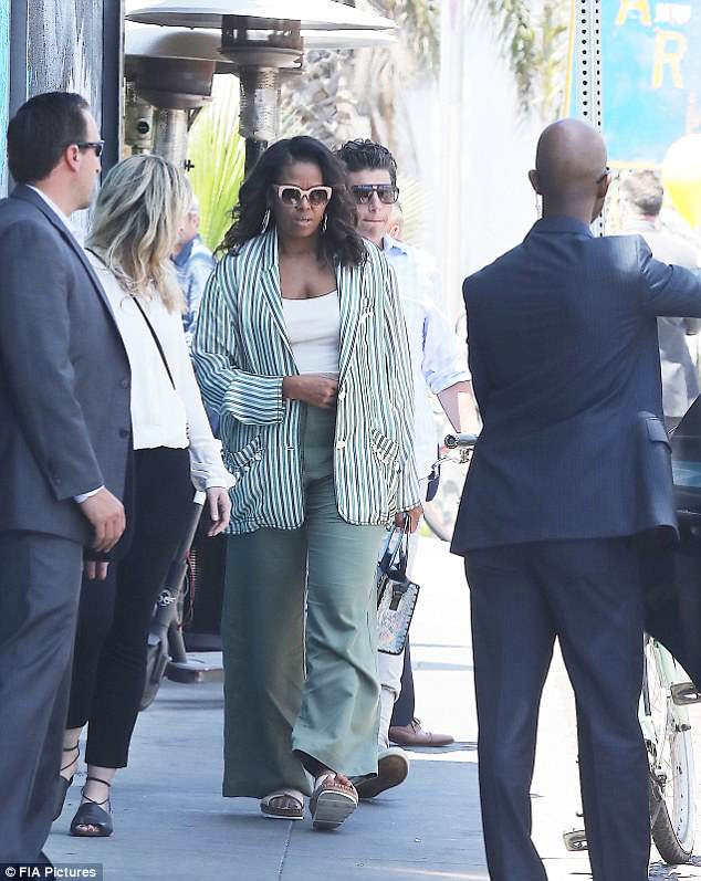 Michelle Obama traded workout clothes for a chic suit as she went out to lunch in Los Angeles on Tuesday