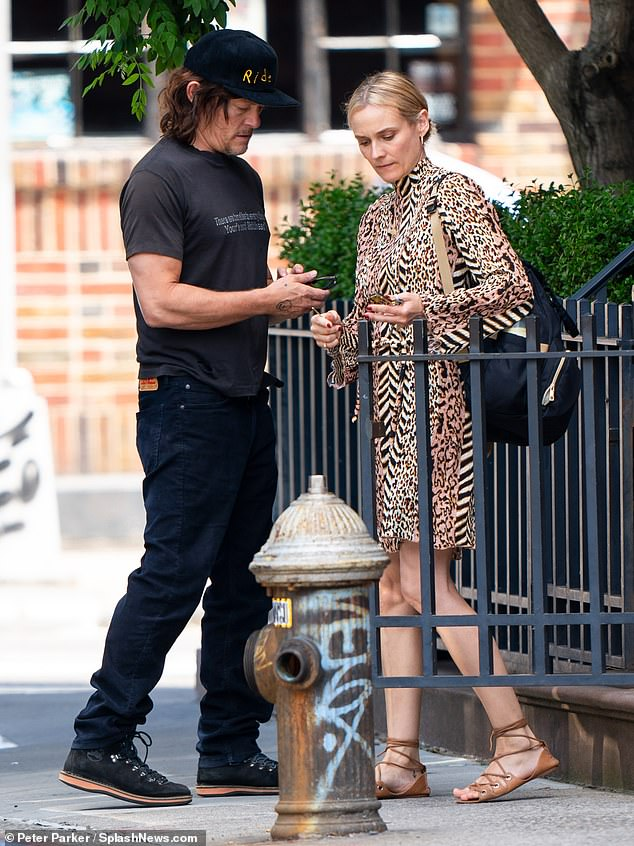 Quick trip: On Monday, Diane Kruger, 42, and Norman Reedus, 50, toted numerous bags out of their apartment in New York City - potentially heading out for a holiday getaway
