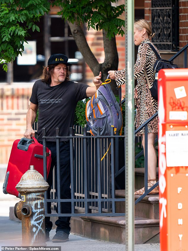 What a guy! Reedus was ever so helpful, grabbing the endless bags from his partner, which consisted of the diaper bag, a red suitcase and another very full looking backpack