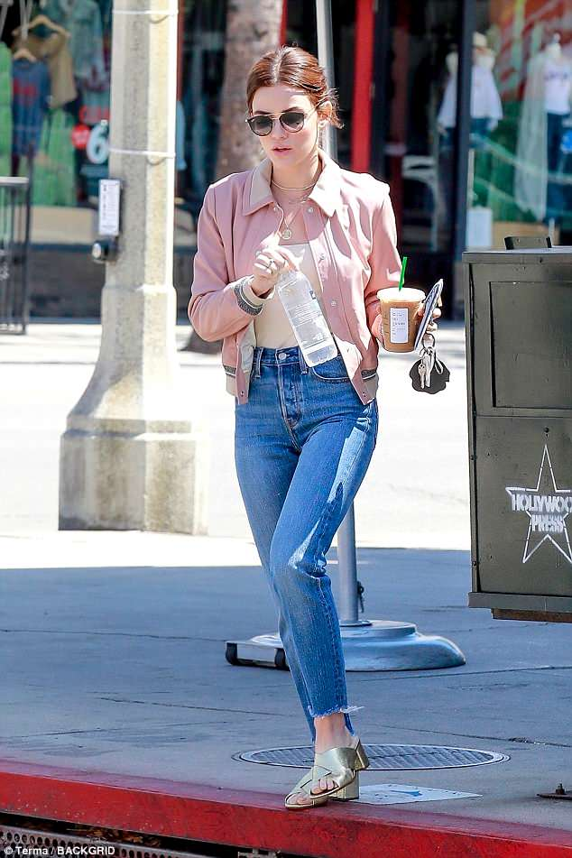 Lovely: Hale added just a touch of sparkle to her otherwise casual ensemble with a pair of glittering gold sandals