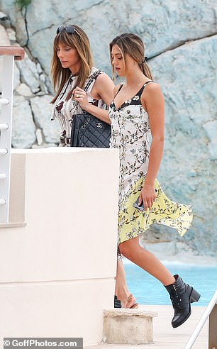 Gorgeous: Jennifer and Sistine donned pretty printed summer dresses for their day in the sunshine