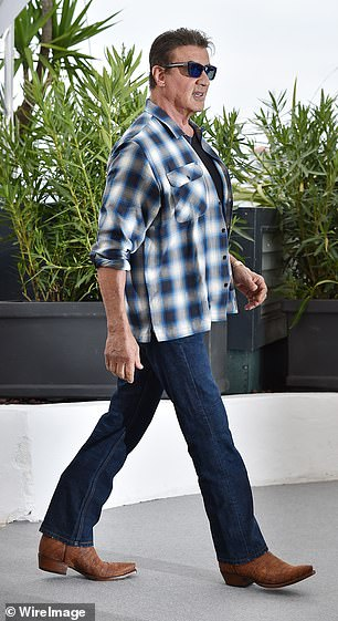 Looking good: Sylvester kept things casual in a pair of slim-fit indigo jeans and a black T-shirt