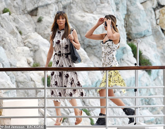 Stylish:The mother and daughter duo looked perfectly in-sync with their flirty frocks, which highlighted their trim frames